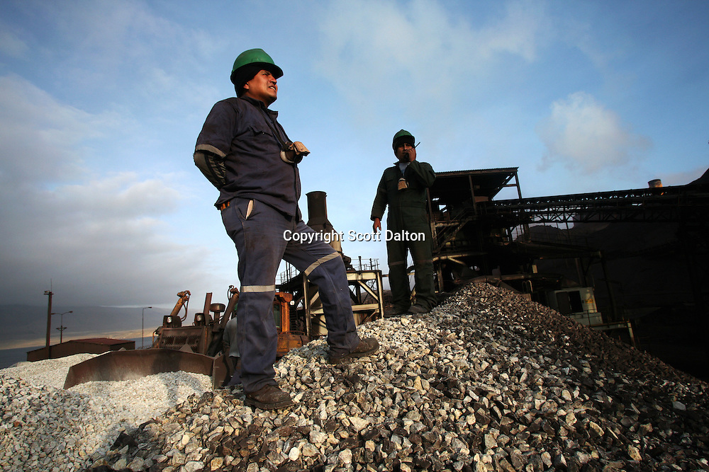 Workers of the Shougang mine at the port of San Nicolas, where Shougang, a Chinese owned mine, exports the minerals extracted from their open pit mine, just outside of Marcona, in southern Peru, on October 25, 2007. (Photo/Scott Dalton)