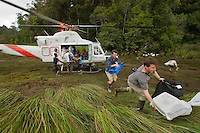 Foja Mountains RAP expedition members unload the helicopter  at the bog landing site at 1650 m elevation.  Kris Helgen is in the foreground, followed by Paul Oliver.