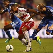 Thierry Henry, New York Red Bulls, (centre) is challenged by Patrice Bernier, (left) and Justin Mapp, Montreal Impact,   during the New York Red Bulls V Montreal Impact, Major League Soccer regular season match at Red Bull Arena, Harrison, New Jersey. USA. 16th March 2013. Photo Tim Clayton