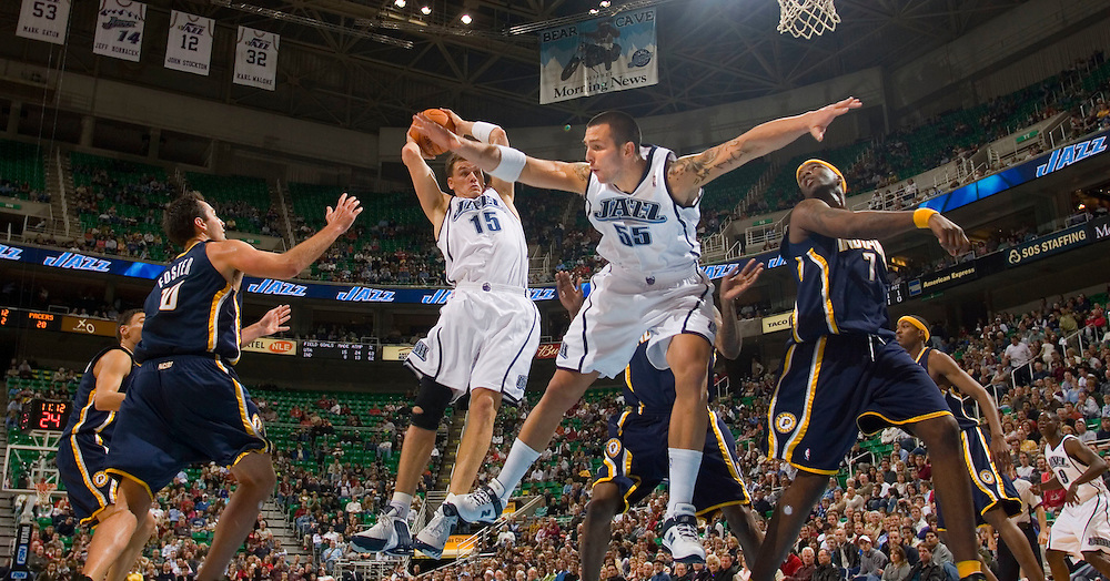 The Utah Jazz's Matt Harping and Rafael Araujo go up for the rebound against the Indiana Pacers during a pre-season game in Salt Lake City, Utah Thursday, Oct. 26, 2006.   August Miller/ Deseret Morning News