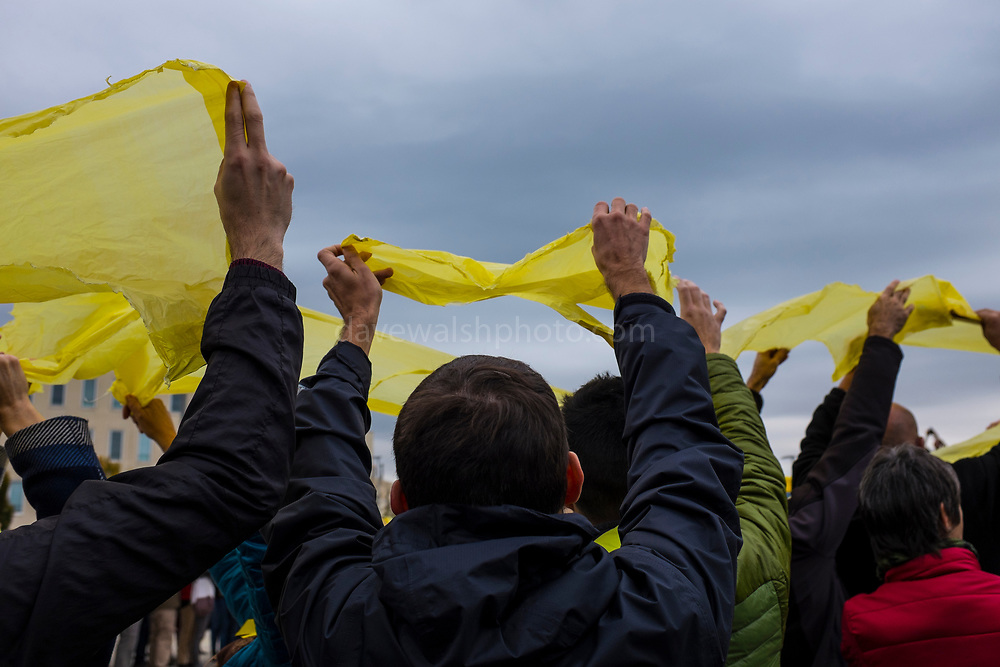 General Strike in Catalonia: Protestors in Sant Cugat del Valles hold up yellow clothes and plastic bags to make a giant ribbon symbol, in protest of the Spanish governments seizing of Catalan media, public services overall autonomy, and the jailing of Catalan government ministers and activists. Dave Walsh 2017. davewalshphoto.com