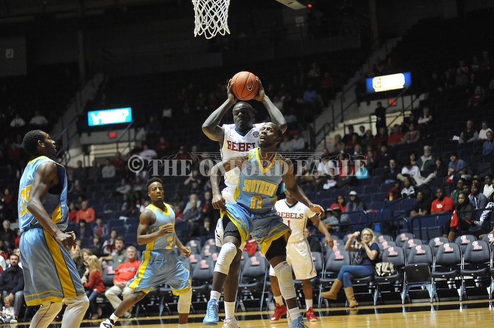 "Ole Miss forward M.J. Rhett (4) catches the ball over southern University Jaguars guard Christopher Hyder (0) and scores at the C.M. ""Tad"" Smith Coliseum in Oxford, Miss. on Thursday, November 20, 2014. (AP Photo/Oxford Eagle, Bruce Newman)"
