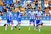 Colchester Utd forward Ben Dickenson celebrates the first goal with team mates during the EFL Sky Bet League 2 match between Colchester United and Cambridge United at the Weston Homes Community Stadium, Colchester, England on 13 August 2016. Photo by Nigel Cole.