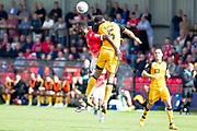 Port Vale defender Leon Legge and Salford City forward Mani Dieseruvwe in areal challenge during the EFL Sky Bet League 2 match between Salford City and Port Vale at Moor Lane, Salford, United Kingdom on 17 August 2019.