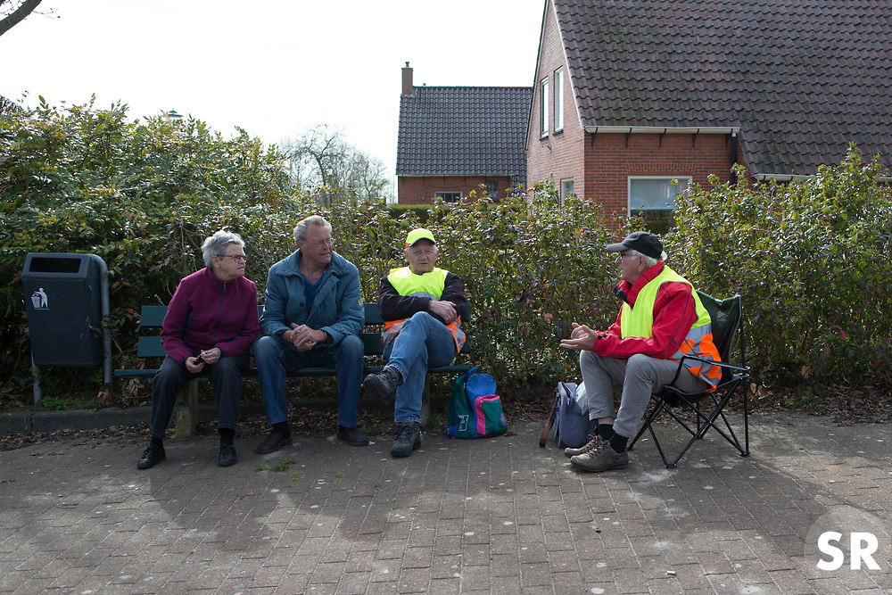Spectators wait for the peloton during Stage 1b of the Healthy Ageing Tour - a 77.6 km road race, starting and finishing in Grijpskerk on April 5, 2017, in Groeningen, Netherlands.