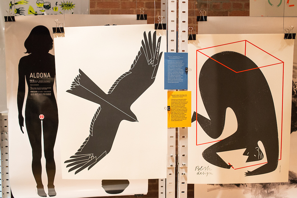 A poster of a raptor (center) by Małgorzata Gurowska and of a figure boxing himself in by Pawel Jońca in the exhibit of Polish graphic design sponsored by Culture.pl, an online magazine of Polish culture sponsored by the Adam Mikiewicz Institute.