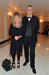 ELIZABETH EMANUEL and ANDREW MARSHALL CEO of Elizabeth Emanuel at the David Shepherd Wildlife Foundation 30th anniversary Wildlife Ball at The Dorchester, Park Lane, London on 10th October 2014.