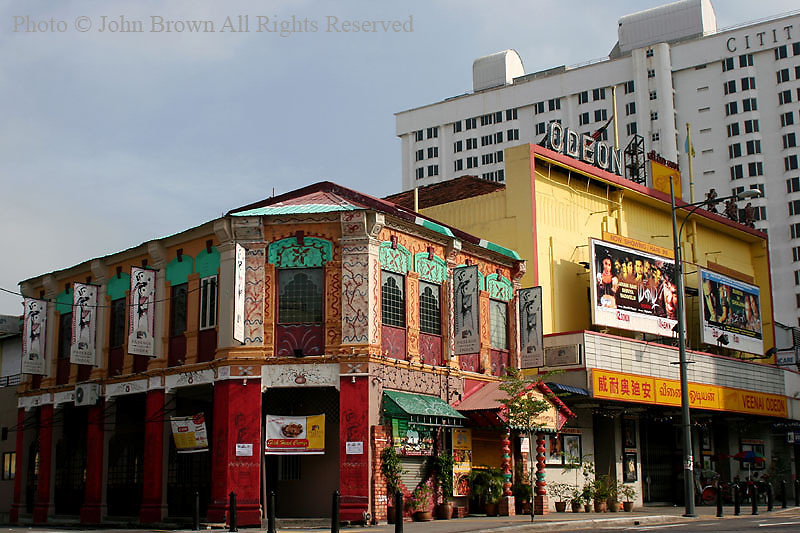 "The Passage Thru India and the Odeon Cinema, which shows movies from India's ""Bolleywood"" form a colorful street corner in the Georgetown district of Penang, Malaysia. The area's resident population is primarily comprised of Muslim, Chinese, and Indian people."