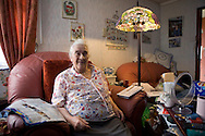 Pamela Clifton in the living room of her prefab at the Excalibur estate in Catford, South London. Pamela has been living in her prefab for 40 years and is fighting to save it as the Lewisham Council want to pull the prefabs down.