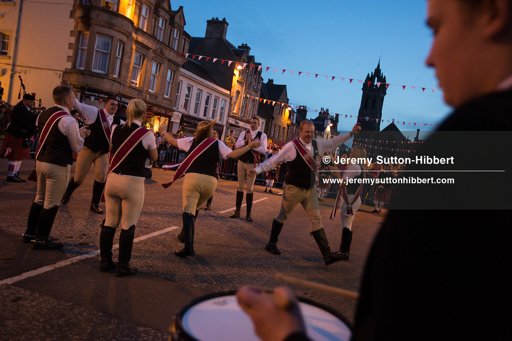 Dancing of the Cornet's Reel, in the High Street, at The Peebles Beltane Festival, including their Common Riding of the Marches, with Cornet Daniel Williamson, and Cornets Elect Lass Susan Thomson, in Peebles, Scotland, Wednesday 19th June 2013. <br /> N55&deg;39.097'<br /> W3&deg;11.443'