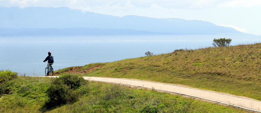Shmuel Thaler/Sentinel<br />A cyclist pauses at the summit of the Great Meadow bike path at UC Santa Cruz as the vista of the Monterey Bay unfolds before him on Monday.