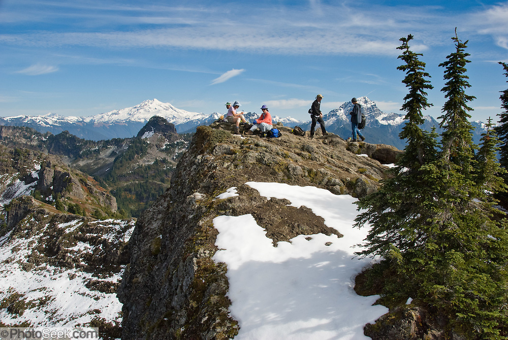 From atop Mount Dickerman, hikers view Glacier Peak and Sloan Peak in Mount  Baker-Snoqualmie National Forest (Trail #710), accessible from the Mountain Loop Highway east of Verlot, Washington, USA.