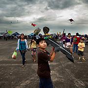 A boy launches a kite at the 2012 Clark, Philippines Hot Air Balloon Festival/Air Show