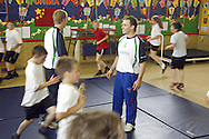 Olympic Gymnast, Daniel Keating visits his old school of Daneholme Juniors in Corby...Daniel, helps premier sports coach, Bob Beevers with a gym class at the school