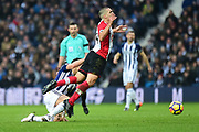 Southampton midfielder Oriol Romeu (14) gets airborne after a tackle during the Premier League match between West Bromwich Albion and Southampton at The Hawthorns, West Bromwich, England on 3 February 2018. Picture by Dennis Goodwin.