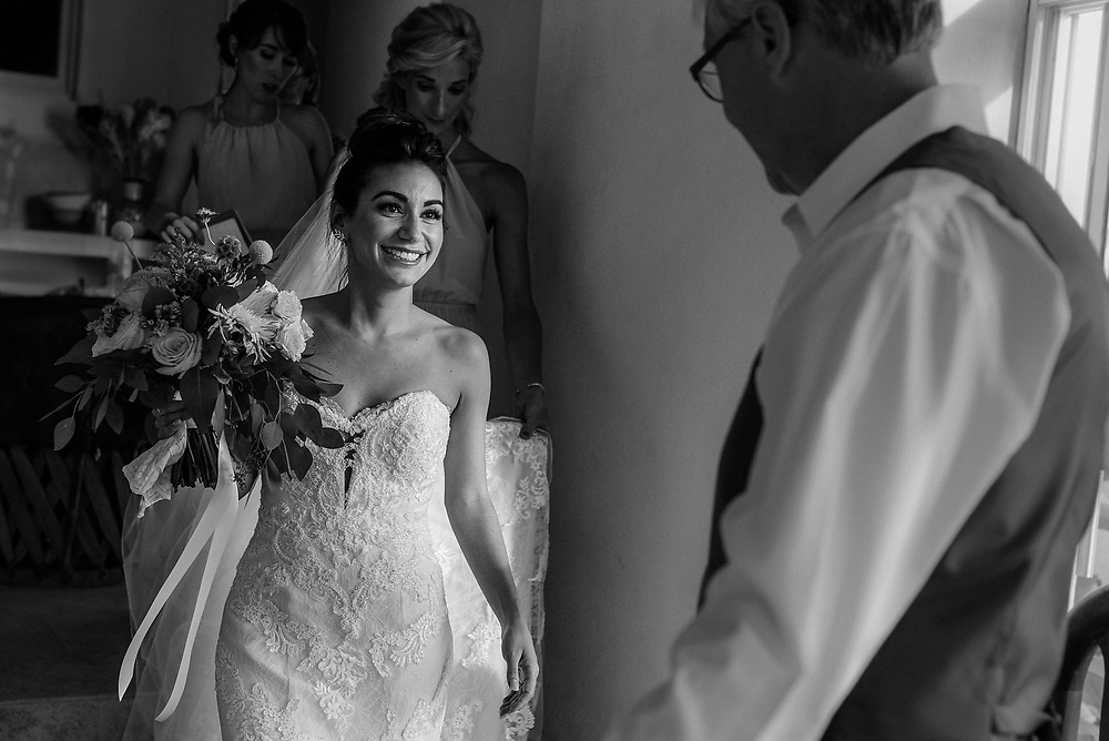 Stefanie meeting her father and giving him her best smile before the ceremony at Sayulita, Nayarit Mexico. Photo by Juan Carlos Calderon.