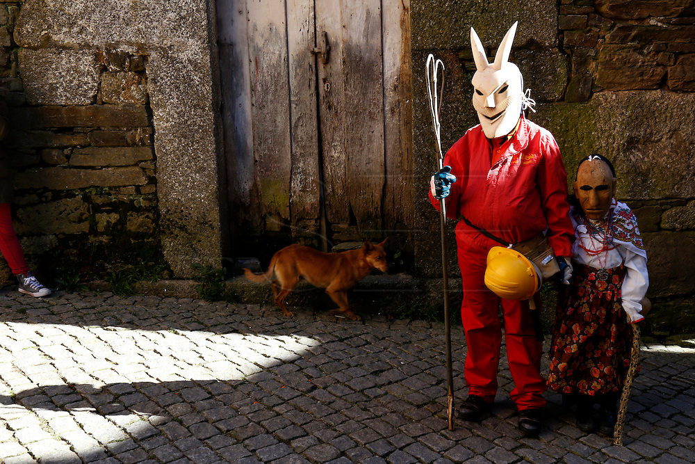 """Revellers with wooden mask and carnival garb during the traditional Celtic carnival """"Caretos"""" in the village of Lazarim, central Portugal on February 17, 2015. PAULO CUNHA /4SEE"""