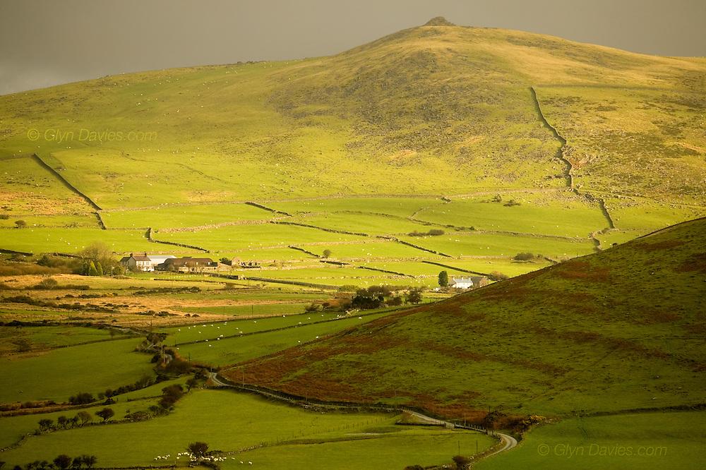 Farmland over gently rolling green hillsides on the Llyn Peninsula, North Wales, as seen from Tre'r Ceiri and Yr Eifl.