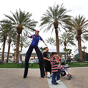 March 1, 2014, Palm Springs, California: <br /> A man on stilts poses with fans during Kids Day at the Indian Wells Tennis Garden sponsored by the Coachella Valley National Junior Tennis and Learning Network.<br /> (Photo by Billie Weiss/BNP Paribas Open)