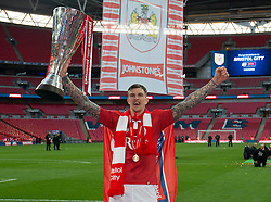 Bristol City's Aden Flint celebrates with the Johnstone Paint Trophy - Photo mandatory by-line: Dougie Allward/JMP - Mobile: 07966 386802 - 22/03/2015 - SPORT - Football - London - Wembley Stadium - Bristol City v Walsall - Johnstone Paint Trophy Final