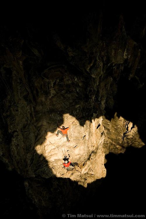Rock climbing in a cave at Crazy Horse, a crag near Chiang Mai, Thailand.