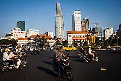 Motorbikes circling Quach Thi Trang roundabout, Ho Chi Minh City, Vietnam, Southeast Asia