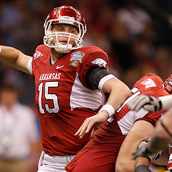 January 4, 2011; New Orleans, LA, USA;  Arkansas Razorbacks quarterback Ryan Mallett (15) throws against the Ohio State Buckeyes during the second quarter of the 2011 Sugar Bowl at the Louisiana Superdome.  Mandatory Credit: Derick E. Hingle