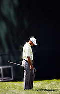 Tiger Woods of the US reacts to a shot falling into a bunker on the sixth hole during the first day of the US Open Golf Championship at Winged Foot Golf Club in Mamaroneck, New York Thursday, 15 June 2006.