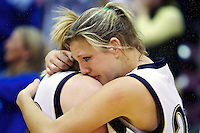 Timberlake High's Caitlyn Nichols consoles her teammate following their 48-44 overtime loss Saturday to Sugar-Salem High at 3A state basketball championship game at the Idaho Center in Nampa.