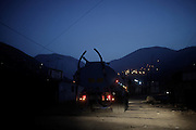 A private water truck enters the human settlement of Pamplona Alta, early Monday, April 17, 2011. (Dado Galdieri)