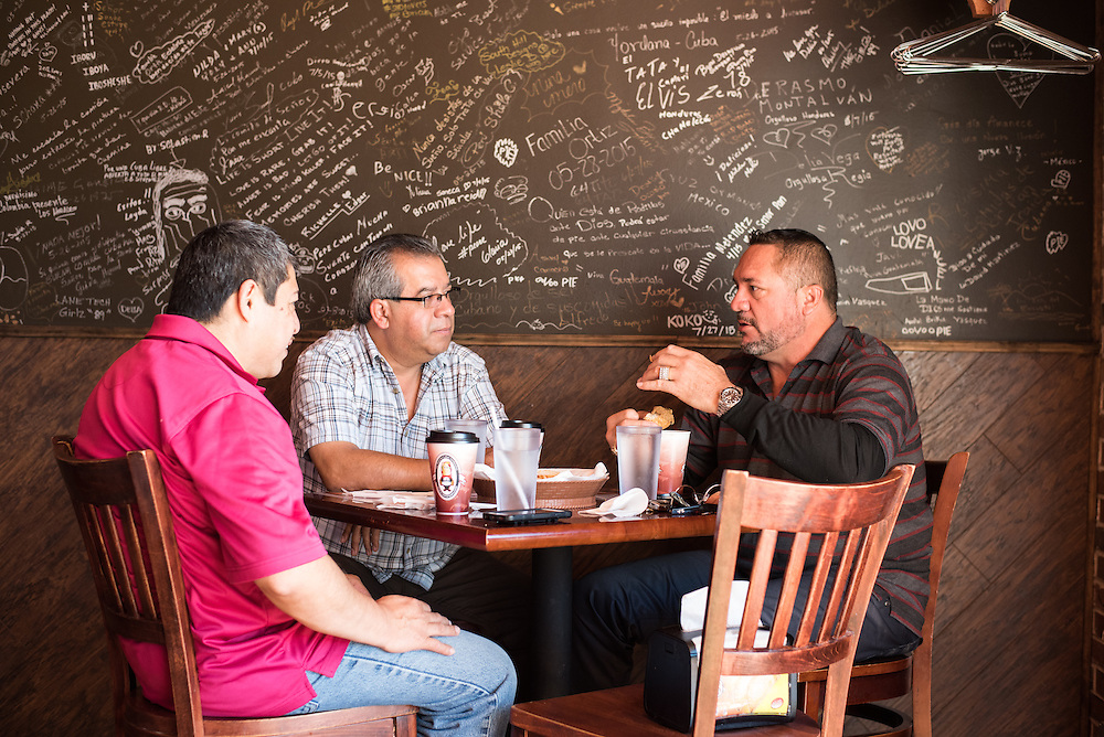 (From Left) Manuel Concua, Jorge Castellanos, and Dr. Silfredo Gonzalez enjoy lunch at the popular Belmont Cragin eatery Señor Pan on Fullerton Avenue, which was one of the first authentic Cuban restaurants in the area when it opened in 2008.