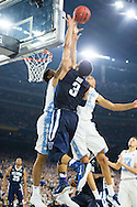 04 APR 2016: Guard Josh Hart (3) of Villanova University shoots against Forward Brice Johnson (11) and Forward Kennedy Meeks (3) of the University of North Carolina during the 2016 NCAA Men's Division I Basketball Final Four Championship game held at NRG Stadium in Houston, TX. Villanova defeated North Carolina 77-74 to win the national title. Brett Wilhelm/NCAA Photos