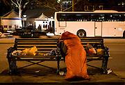 A homeless woman sleeps in her sleeping bag on Victoria Embankment, London.