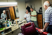 John Talarico looks on as his wife Margie talks with Monessen Mayor Lou Mavrakis in Tallarico's barber shop in the basement of his home in Monessen. Pa.<br /> <br /> Monessen, a third-class city, faces the same problems as th other former steel towns — declining population and tax revenue after the mills shut down. The city's population has dropped to 7,600 from a high of 20,268 in 1930.