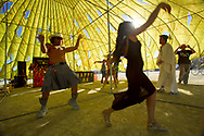 BLACK ROCK CITY, NV:  Two dancers enjoy the afternoon at a theme camp in Black Rock City, Nevada.  One of the ways people participate in the Burning Man festival is by building theme camps for residents of Black Rock City.  Once participants enter the city there is no exchange of money.