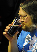 © Licensed to London News Pictures. 07/03/2012. London, UK. A man smells a half pint of beer before tasting. The Campaign for Real Ales' (CAMRA) London Drinker Beer & Cider Festival at the Camden Centre, London today 07 March 2012. Over 70 real ales, ciders and perries from over 50 breweries are available alongside imported beers. The festival runs Wednesday 07 March 2012 - Saturday 10 March 2012. Photo credit : Stephen SImpson/LNP