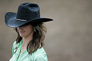 062009-Evergreen, Colo.-queenshc-2010 Evergreen Rodeo Queen Kari Peterson answers questions from the judges as the rain pours down during the 2009 Evergreen Rodeo Queens Horsemanship Competition Saturday, June 20, 2009 at The Evergreen Rodeo Grounds..Photo By Matthew Jonas/Evergreen Newspapers/Photo Editor