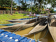 19 JUNE 2016 - DON KHONE, CHAMPASAK, LAOS: Tourist boats parked at the main dock in Don Khone on Don Khone Island. Don Khone Island, one of the larger islands in the 4,000 Islands chain on the Mekong River in southern Laos. The island has become a backpacker hot spot, there are lots of guest houses and small restaurants on the north end of the island.      PHOTO BY JACK KURTZ