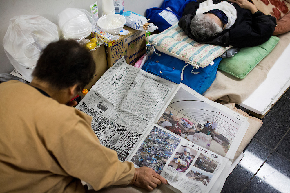 KUMAMOTO, JAPAN - APRIL 21:  Earthquake survivors reads newspaper in the morning of April 21, 2016 in Mashiki Gymnasium evacuation center, Kumamoto, Japan. To date 45 people are confirmed dead and around 11,000 people have evacuated after an 6.5 earthquake on Thursday night and a stronger 7.3 quake on Saturday morning struck the Kyushu Island in western Japan.<br /> <br /> Photo: Richard Atrero de Guzman