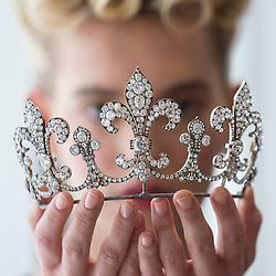 "© Licensed to London News Pictures. 19/10/2018. LONDON, UK. A model presents a diamond tiara, Hübner, circa 1912, of a fleur de lys design, with diamonds (USD350k-550k) from Charles X, King of France. Preview of Sotheby's ""Royal Jewels from the Bourbon-Parma Family"", a family descended from Louis XIV of France, the Holy Roman Emperors and from Pope Paul III, with links to the most important ruling families of Europe.  Led by a breath-taking group of jewels which once belonged to Marie Antoinette, queen of France, the collection of jewels will be offered for sale at Sotheby's in Geneva on 14 November 2018.  Photo credit: Stephen Chung/LNP"