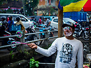 06 AUGUST 2017 - MENGWI, BALI, INDONESIA:  A toy vender in the Bringkit Market in Mengwi, about 30 minutes from Denpasar. Bringkit Market is famous on Bali for its Sunday livestock and poultry market. Hundreds of the small Bali cows are bought and sold there every week. Bali's local markets are open on an every three day rotating schedule because venders travel from town to town. Before modern refrigeration and convenience stores became common place on Bali, markets were thriving community gatherings. Fewer people shop at markets now as more and more consumers go to convenience stores and more families have refrigerators.    PHOTO BY JACK KURTZ