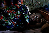 Hakumagutuma Miger, 56, lies down on the bed at health clinic near Shasha camp for IDPs (Internally Displaced Persons)  The long war, which had involved 9 African nations and claimed an estimated three million lives as a result of fighting or disease and malnutrition..Photo by Kuni Takahashi.