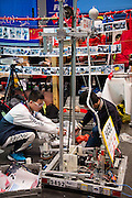 March 13, 2015 - New York, NY. One of two high school teams from China readies their robot for the FIRST Robotics Competition at the Jacob Javits Center. 03/13/2015 Photograph by Allegra Abramo
