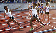 Newburgh Free Academy's Saleen Matta, left, takes the baton from teammate D'Yanna McCaskill to run the final leg of the 1,600-meter relay at the Section 9 track and field state qualifier in Middletown on Friday, May 31, 2013. Newburgh won the race.