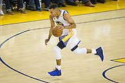 Golden State Warriors guard Stephen Curry (30) pushes the ball down court against the San Antonio Spurs at Oracle Arena in Oakland, Calif., on October 25, 2016. (Stan Olszewski/Special to S.F. Examiner)