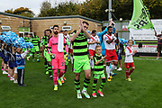 The two teams enter the field during the EFL Sky Bet League 2 match between Forest Green Rovers and Newport County at the New Lawn, Forest Green, United Kingdom on 14 October 2017. Photo by Shane Healey.