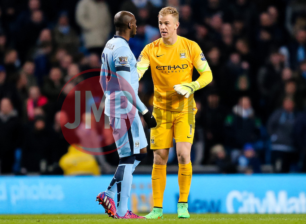 Manchester City's Joe Hart gives instructions to Manchester City's Eliaquim Mangala  - Photo mandatory by-line: Matt McNulty/JMP - Mobile: 07966 386802 - 04/03/2015 - SPORT - football - Manchester - Etihad Stadium - Manchester City v Leicester City - Barclays Premier League