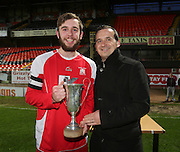 Grove captain Ben Finnie is presented with the Senior Johnston Trophy Final by Neil Lowden (president of Dundee Schools FA) after his team beat Morgan in the final at tannadice<br /> <br />  - &copy; David Young - www.davidyoungphoto.co.uk - email: davidyoungphoto@gmail.com