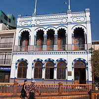 "According to ""Wikipedia"" - Iquique's 19th century architecture can be visited mainly downtown. Its origins are linked with the mining activities during that century, when European entrepreneurs became rich with the extraction of saltpetre and established their homes in the city. Many of them constructed big houses in different styles that predominated during the period and grouped in colonies with their respective buildings, with special stylistic, material and constructive adaptations to the climate of Iquique."