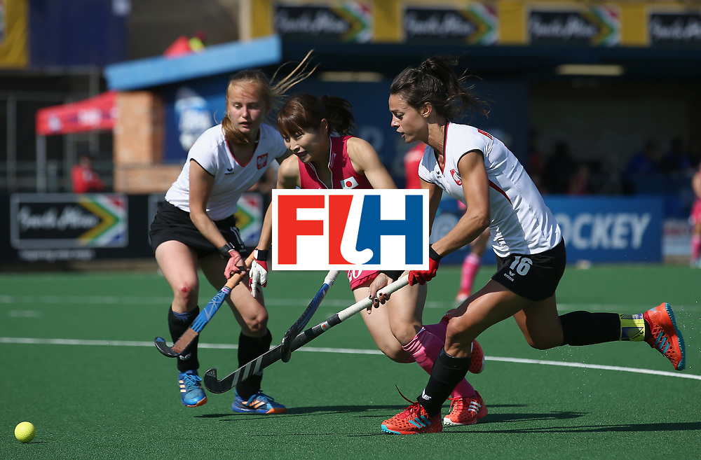 JOHANNESBURG, SOUTH AFRICA - JULY 14: Minami Shimizu of Japan  and Marlena Rybacha of Poland battle for possession during day 4 of the FIH Hockey World League Semi Finals Pool B match between Poland and Japan at Wits University on July 14, 2017 in Johannesburg, South Africa. (Photo by Jan Kruger/Getty Images for FIH)